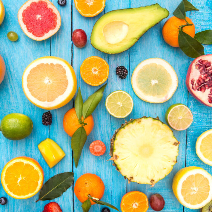 52773102 - mix of colored fruits on white wooden background - composition of tropical and mediterranean fruits - concepts about decoration, healthy eating and food background